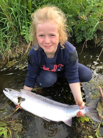 young girl holding a salmon